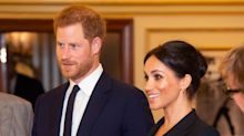 Meghan Markle breaks protocol in tuxedo mini dress for a night at the theatre with Prince Harry