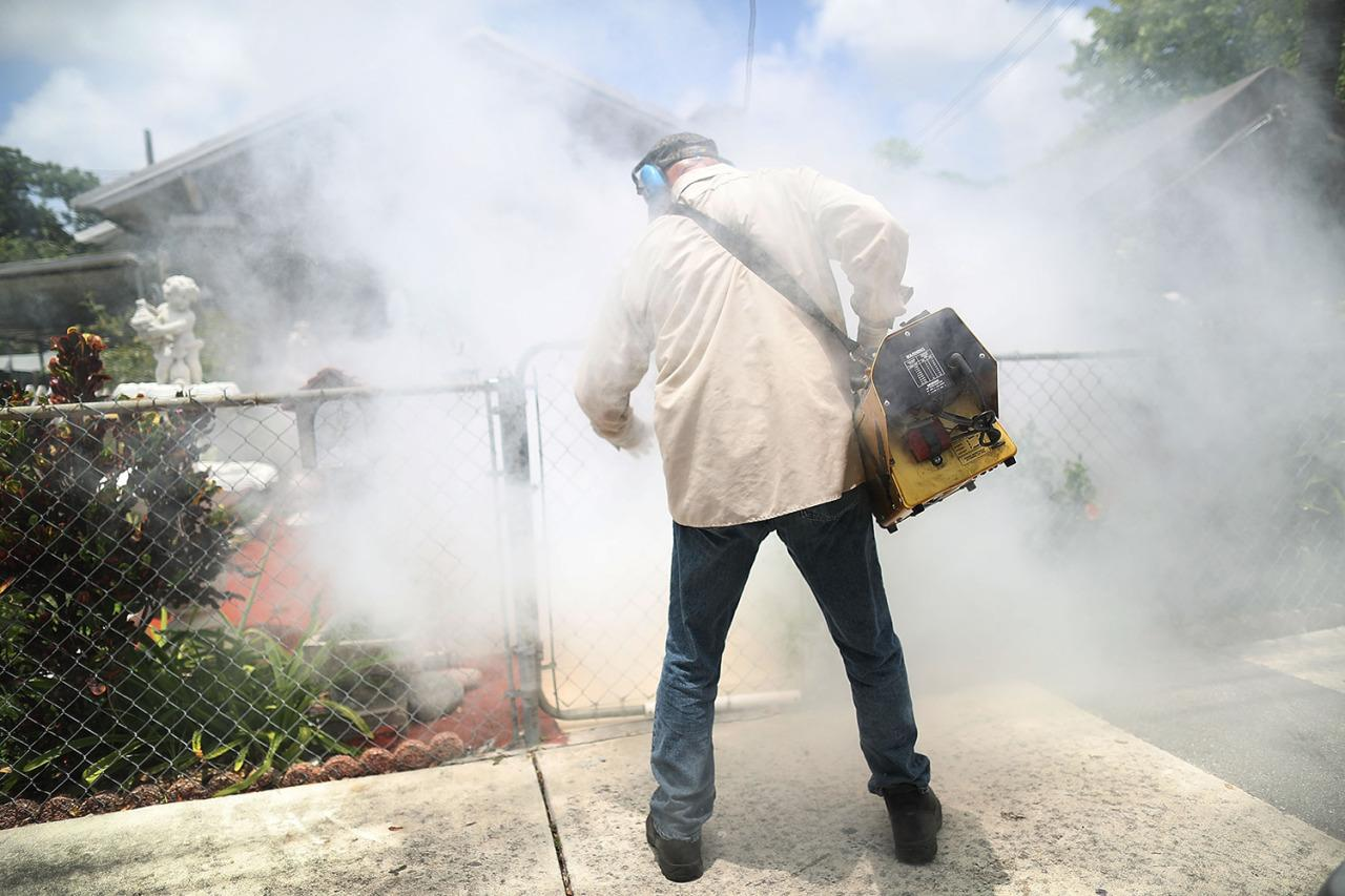 <p>Carlos Varas, a Miami-Dade County mosquito control inspector, uses a Golden Eagle blower to spray pesticide to kill mosquitos in the Wynwood neighborhood as the county fights to control the Zika virus outbreak on Aug. 2, 2016 in Miami, Fla. (Joe Raedle/Getty Images)</p>