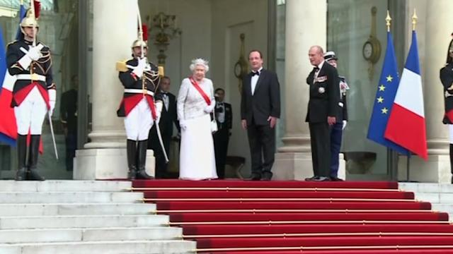 Queen Elizabeth arrives for state dinner at Elysee palace