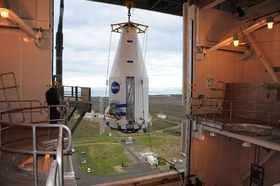 The payload faring containing the Landsat Data Continuity Mission LDCM spacecraft is lifted to the top of Space Launch Complex-3E at Vandenberg Air Force Base where it will be hoisted atop a United Launch Alliance Atlas V for launch. Image rele