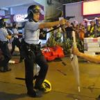 Hong Kong police filmed pointing guns at protesters amid claims shot was fired