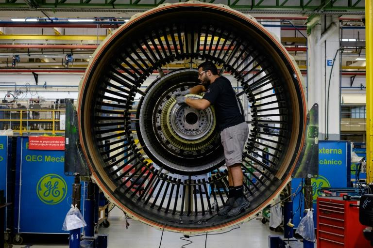 A man works with a jet engine at General Electric (GE) Celma, GE's aviation engine overhaul facility in Rio de Janeiro, Brazil