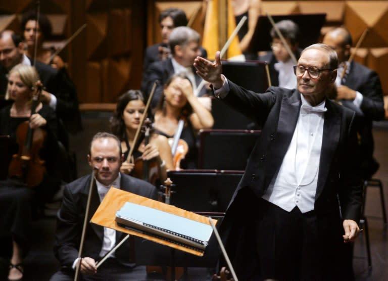 Morricone was considered a fine conductor, too (AFP Photo/GIULIO NAPOLITANO)
