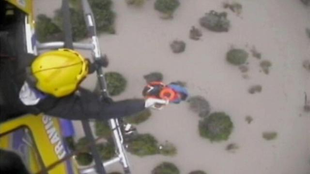 Texas Flash Floods Prompt Roof Rescues