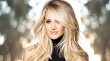 Carrie Underwood 'stronger than ever' as she laughs off plastic surgery rumours