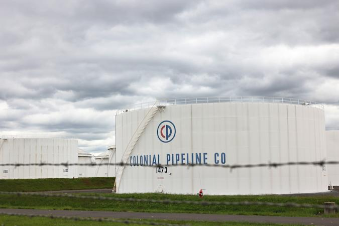 WOODBRIDGE, NEW JERSEY - MAY 10: Fuel holding tanks are seen at Colonial Pipeline's Linden Junction Tank Farm on May 10, 2021 in Woodbridge, New Jersey. Alpharetta, Georgia-based Colonial Pipeline, which has the largest fuel pipeline, was forced to shut down its oil and gas pipeline system on Friday after a ransomware attack that has slowed down the transportation of oil in the eastern U.S. On Sunday, the federal government announced an emergency declaration that extends through June 8th and can be renewed. On Monday, the FBI confirmed that the cyberattack was carried out by DarkSide, a cybercrime gang believed to operate out of Russia. (Photo by Michael M. Santiago/Getty Images)