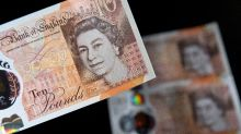 British pound rallies on May's Brexit setback; stocks gain