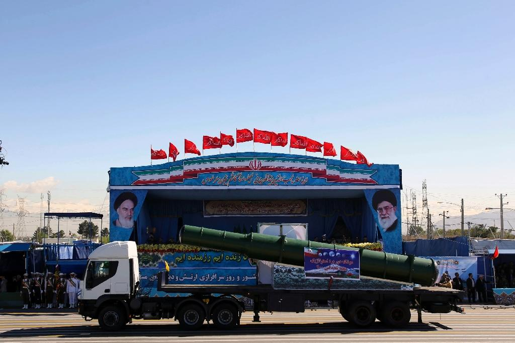 An Iranian military truck carries parts of the S200 missile system during the Army Day parade in Tehran on April 17, 2015