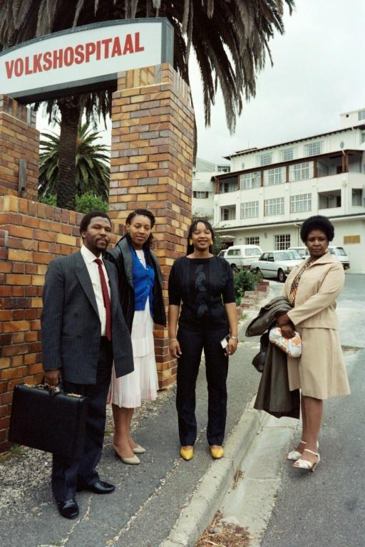 File picture from November 1985 at the height of the apartheid era: Winnie Madikizela-Mandela with her daughters Zenani, centre, and Zindzi, left, visiting Nelson Mandela after he underwent surgery in a Cape Town hospital (AFP Photo/Gideon Mendel)