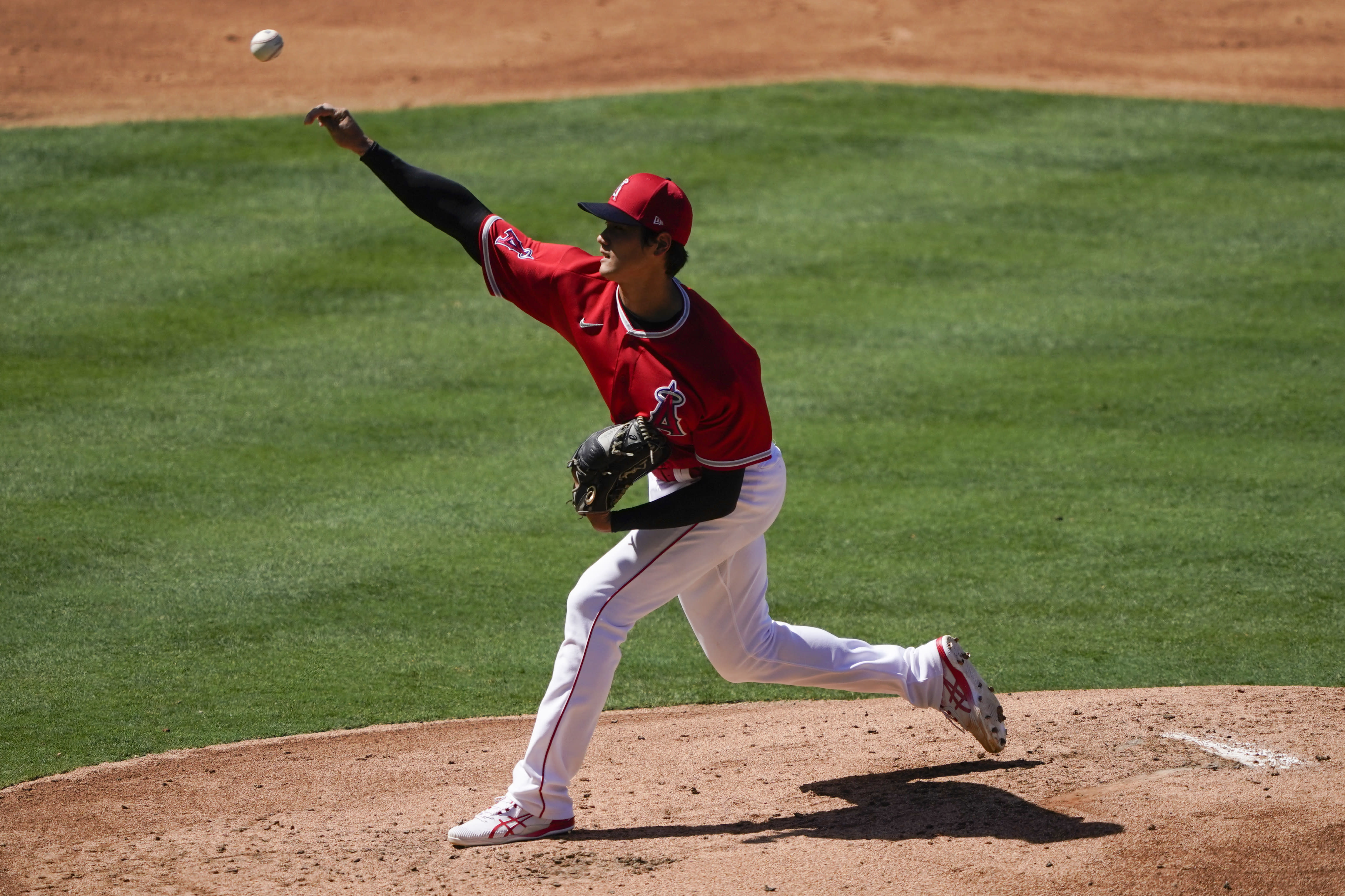 Los Angeles Angels' Shohei Ohtani pitches during an intrasquad game at baseball practice at Angel Stadium on Tuesday, July 7, 2020, in Anaheim, Calif. (AP Photo/Ashley Landis)