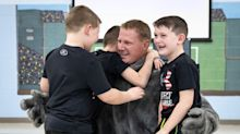 Deployed Dad Dressed as School Mascot Surprises Three Sons in Rockland