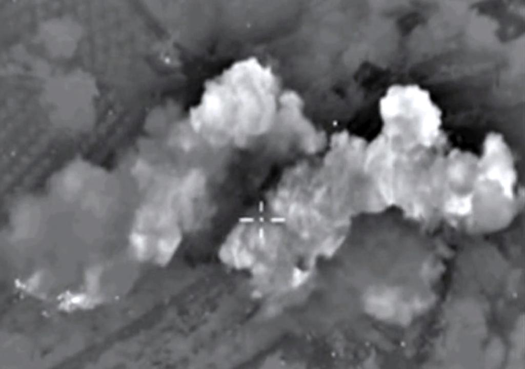 A Russian Defence Ministry image purports to show airstrikes carried out by the Russian air force on an Islamic State ammunition depot in the Syrian province of Hama in October