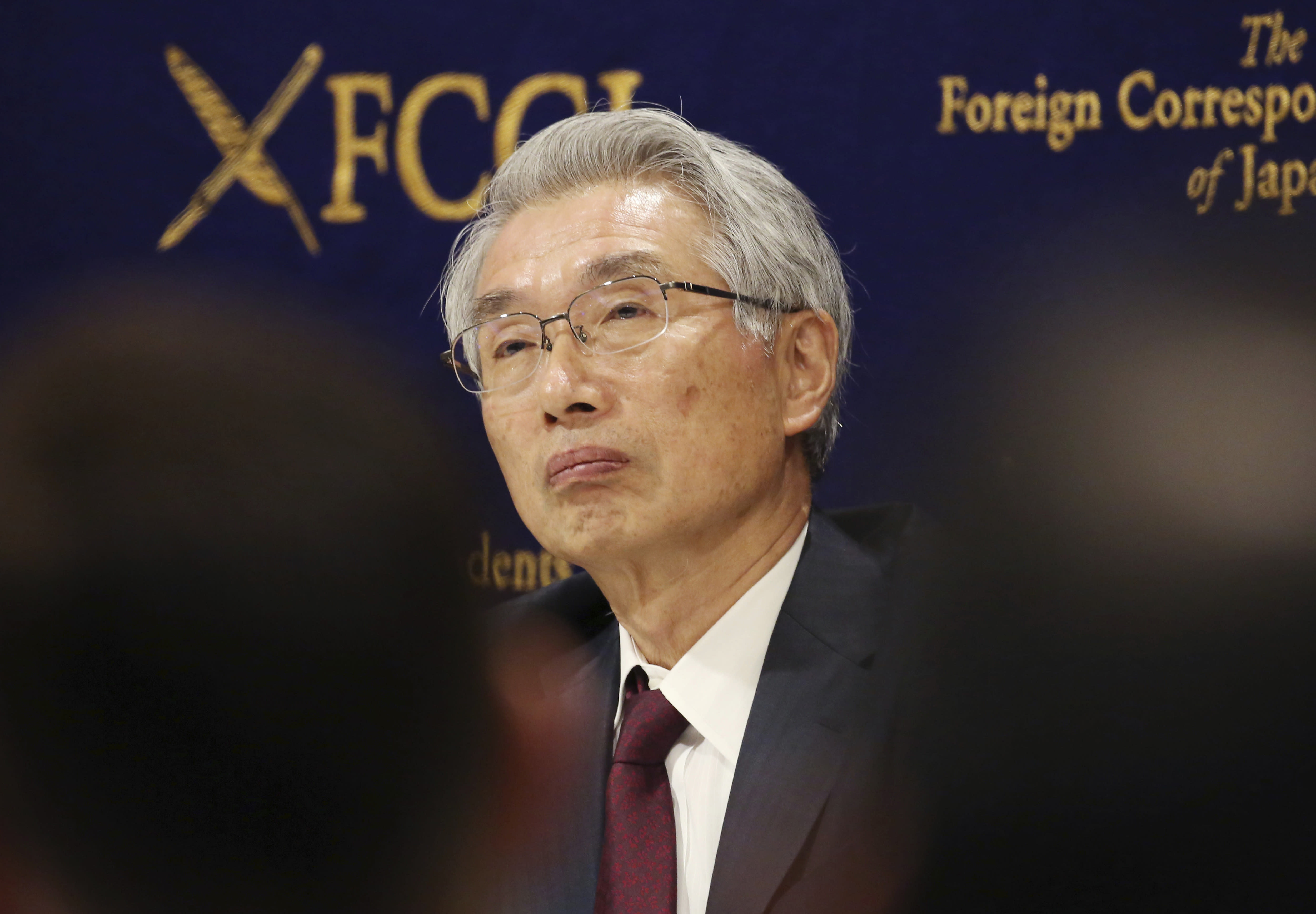 Junichiro Hironaka, Chief defense lawyer of former Nissan chairman Carlos Ghosn speaks during a press conference in Tokyo, Monday, March 4, 2019. Hironaka said Monday that Ghosn promised to accept camera surveillance as a way to monitor his activities if he is released from the detention center where he has been held since his Nov. 19 arrest. Ghosn has been charged with falsifying financial reports and breach of trust. (AP Photo/Koji Sasahara)