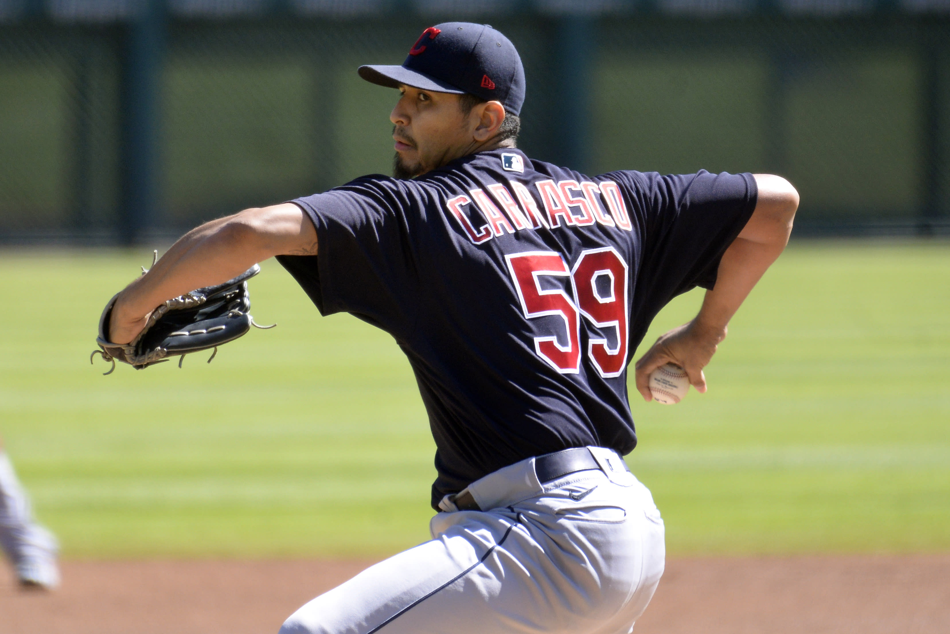 Cleveland Indians starting pitcher Carlos Carrasco throws against the Detroit Tigers in the first inning of a baseball game, Sunday, Sept. 20, 2020, in Detroit. (AP Photo/Jose Juarez)