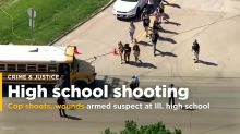 Illinois officer shoots, wounds armed suspect at high school