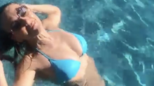 Elizabeth Hurley, 54, flaunts her 'killer body' and blue bikini in stunning swimming pool video