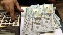 Dollar dips as Fed signals pause in rate-cutting cycle