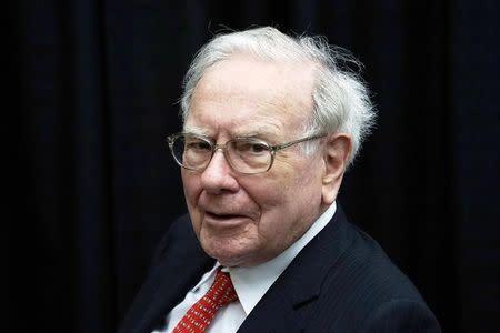 FILE PHOTO: Berkshire Hathaway CEO Warren Buffett plays bridge during the Berkshire annual meeting weekend in Omaha