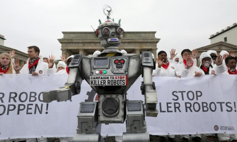 """Demonstrators in Berlin take part in a """"Stop Killer Robots"""" campaign organized by German NGO """"Facing Finance"""" to ban what they call killer robots, in March 2019"""