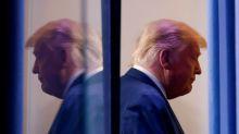Explainer: Can Trump pardon his associates — or himself?