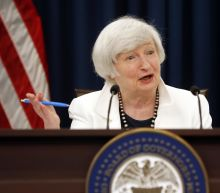 Stocks slip from record levels after Fed's hawkish stance