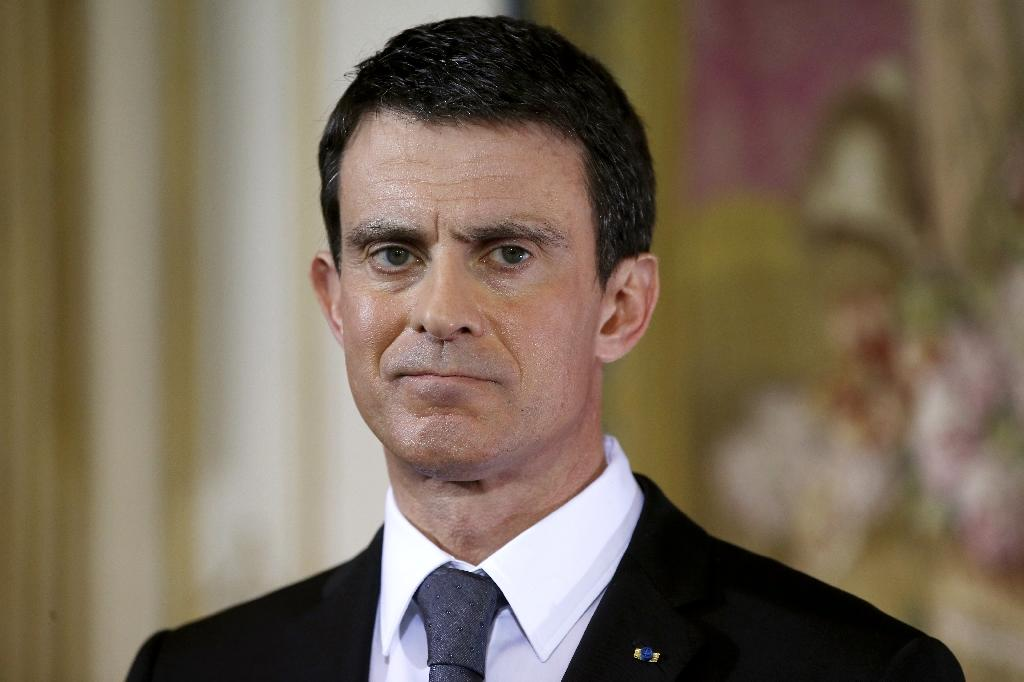 "French Prime Minister Manuel Valls, pictured on February 8, 2016, told German regional media group Funke that Germany's liberal refugee policy is ""unsustainable in the long term"" (AFP Photo/Patrick Kovarik)"