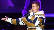 Justin Bieber Shows Off New 'Son of God' Tattoo During Concert in Italy
