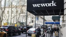 WeWork will still list its shares on the NASDAQ