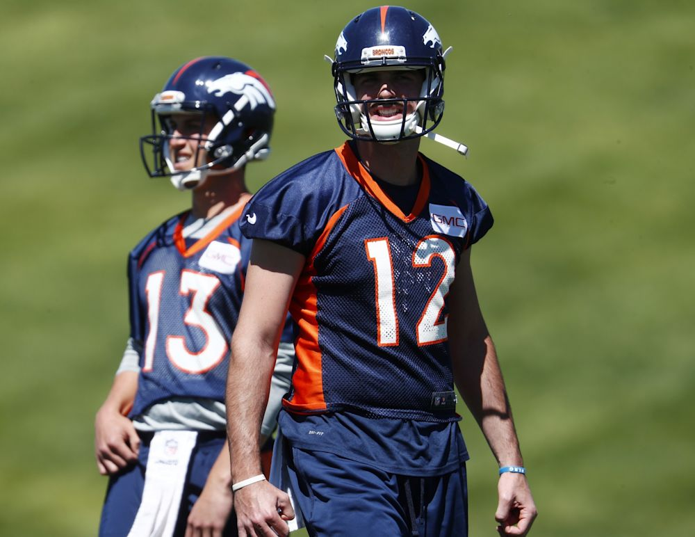 Paxton Lynch (12) is trailing Trevor Siemian in the battle for the starting Broncos QB job. (AP)