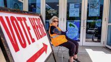 Eight U.S. states cast ballots on biggest voting day since coronavirus pandemic