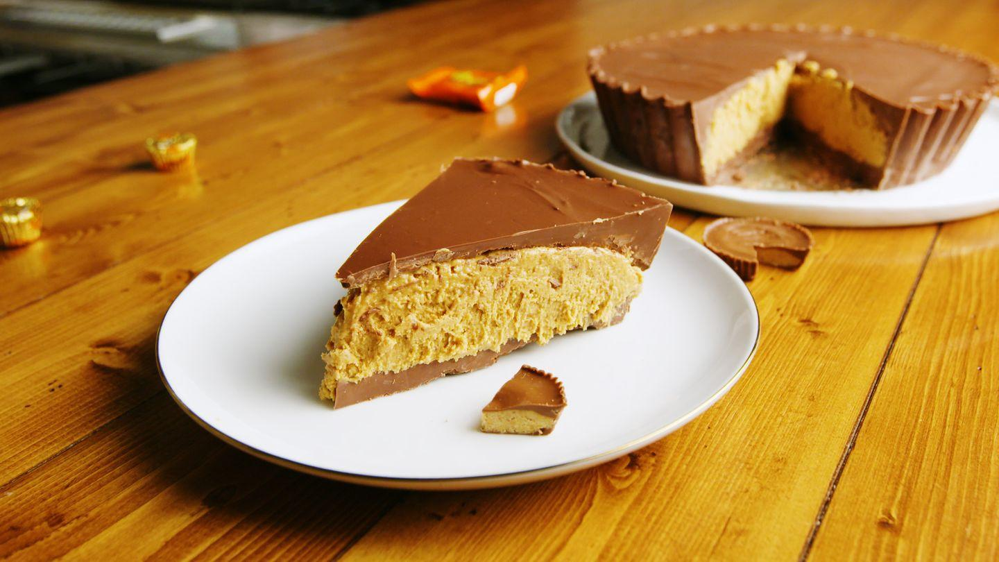 """<p>Nope, that's not a pie: It's a slice of a GIANT Reese's Cup that you can share with all your friends.</p><p>Get the recipe from <a href=""""https://www.delish.com/cooking/a23334746/giant-reeses-recipe/"""" rel=""""nofollow noopener"""" target=""""_blank"""" data-ylk=""""slk:Delish"""" class=""""link rapid-noclick-resp"""">Delish</a>.</p><p><a class=""""link rapid-noclick-resp"""" href=""""https://go.redirectingat.com?id=74968X1596630&url=https%3A%2F%2Fwww.barnesandnoble.com%2Fw%2Fdelish-editors-of-delish%2F1127659306%3Fst%3DAFF%26SID%3DBarnes%2B%2526%2BNoble%2B-%2BTop%2B100%253A%2BBook%2BBestsellers%262sid%3DSkimlinks_7689440_NA&sref=http%3A%2F%2Fwww.delish.com%2Fholiday-recipes%2Fchristmas%2Fg1706%2Fhomemade-christmas-candy-recipes%2F"""" rel=""""nofollow noopener"""" target=""""_blank"""" data-ylk=""""slk:GET YOURS NOW"""">GET YOURS NOW</a> <strong><em>Delish Cookbook, barnesandnoble.com</em></strong></p>"""