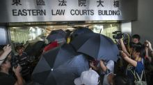 Hundreds of supporters turn out at Hong Kong court as three anti-government protesters face charges of rioting and assaulting police officers