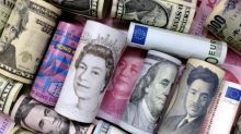 Dollar gains as investors book profits on short positions