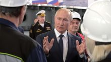 Putin attends keel-laying of new warships in annexed Crimea