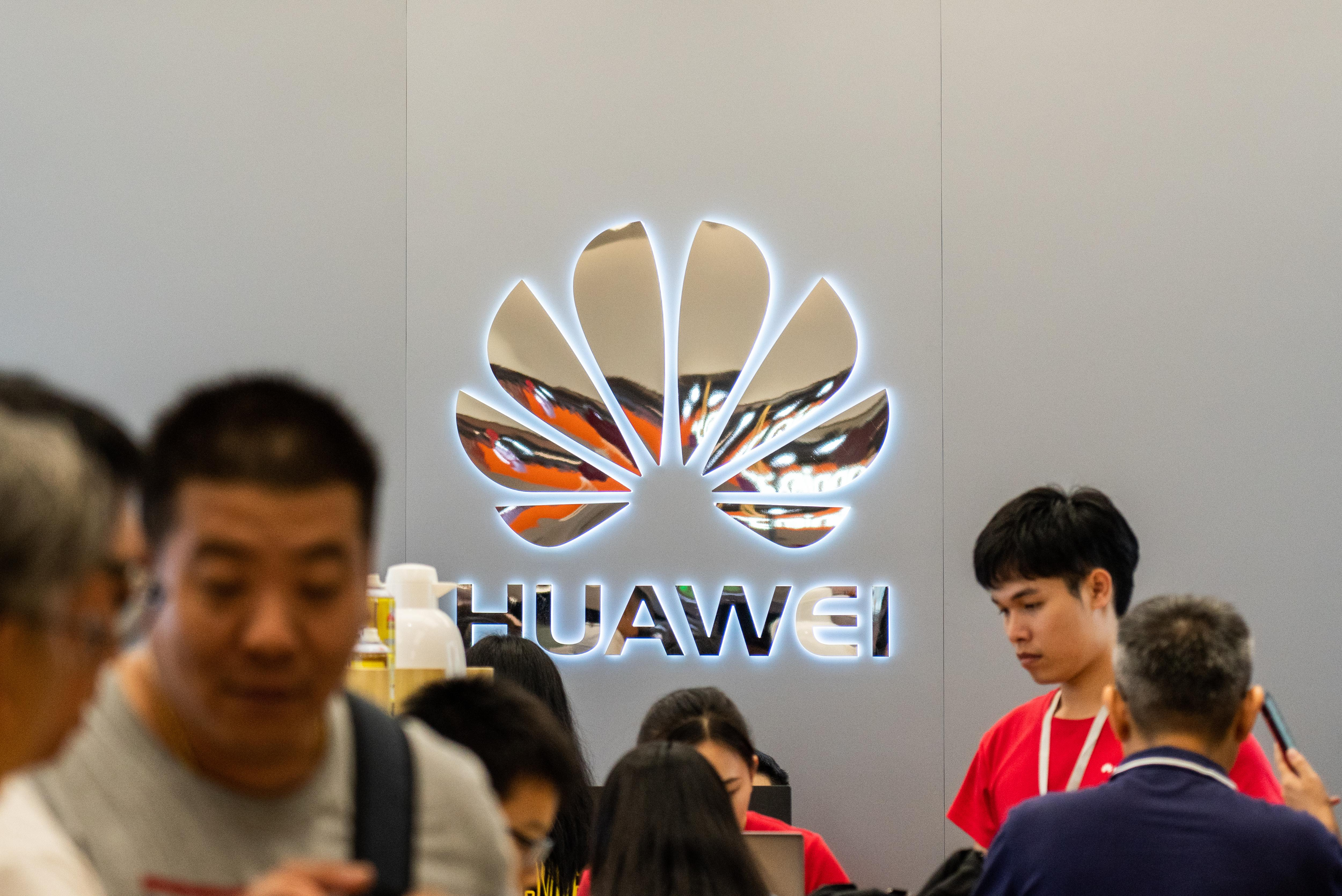 Customers at a Chinese multinational technology company,...