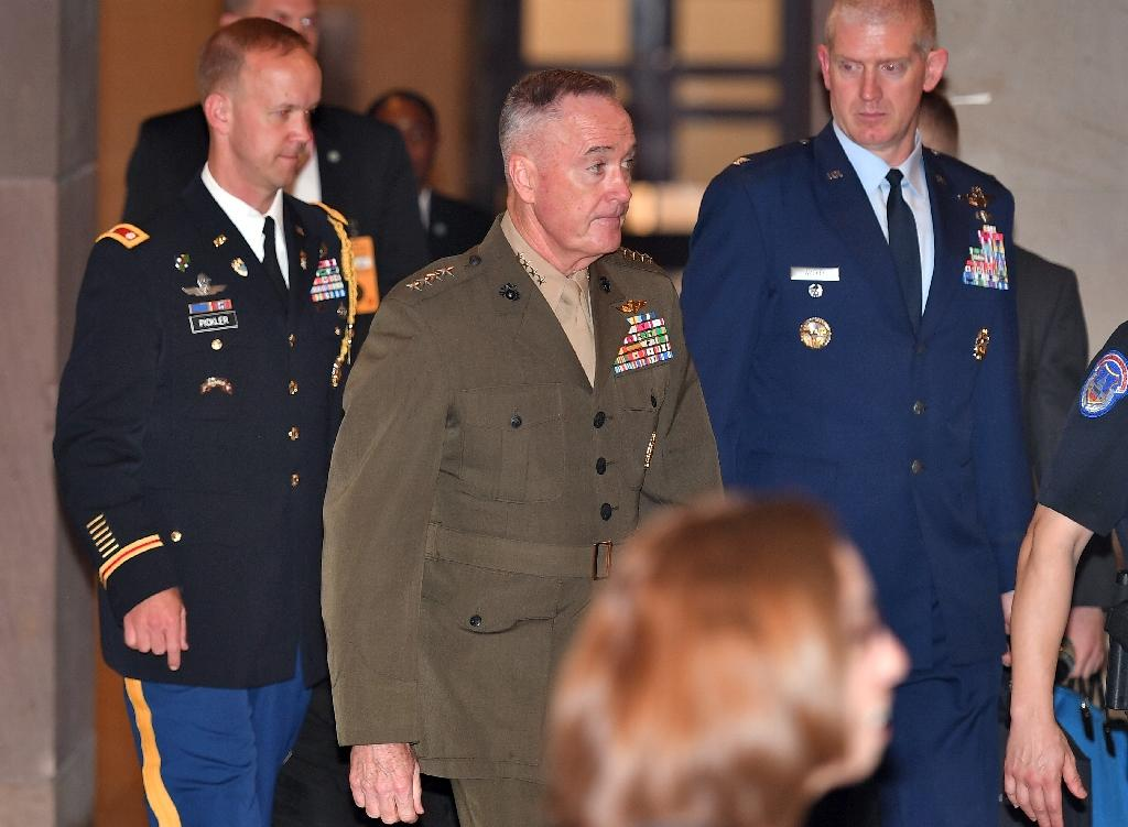 """Joint Chiefs of Staff Chairman General Joseph Dunford (C) says """"collective action"""" is needed to counter China's militarization of the South China Sea"""