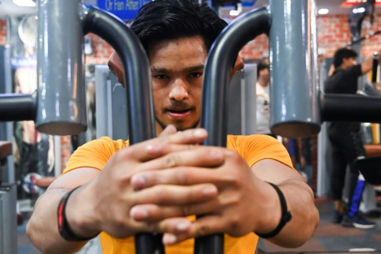 Many workout dens are defying government orders of a lockdown by staying open for their muscle-bound customers (AFP Photo/Sajjad HUSSAIN)