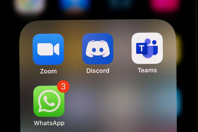 This illustration picture taken on May 27, 2020 in Paris shows the logos of the social networks  applications Zoom, Discord, Teams and WhatsApp on the screen of a phone. (Photo by Martin BUREAU / AFP) (Photo by MARTIN BUREAU/AFP via Getty Images)