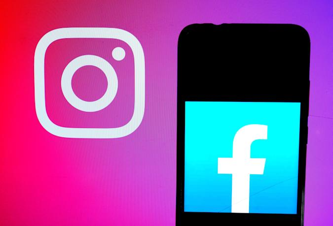 INDIA - 2020/09/02: In this photo illustration a Facebook logo  seen displayed on a smartphone with an Instagram logo on the background. (Photo Illustration by Avishek Das/SOPA Images/LightRocket via Getty Images)