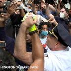 One of NYC's top cops takes a knee, hugs George Floyd protesters