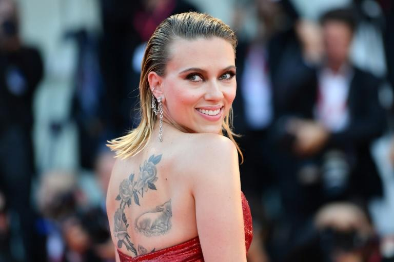 US actress Scarlett Johansson, pictured at the 2019 Venice Film Festival, says she sees Woody Allen whenever she can