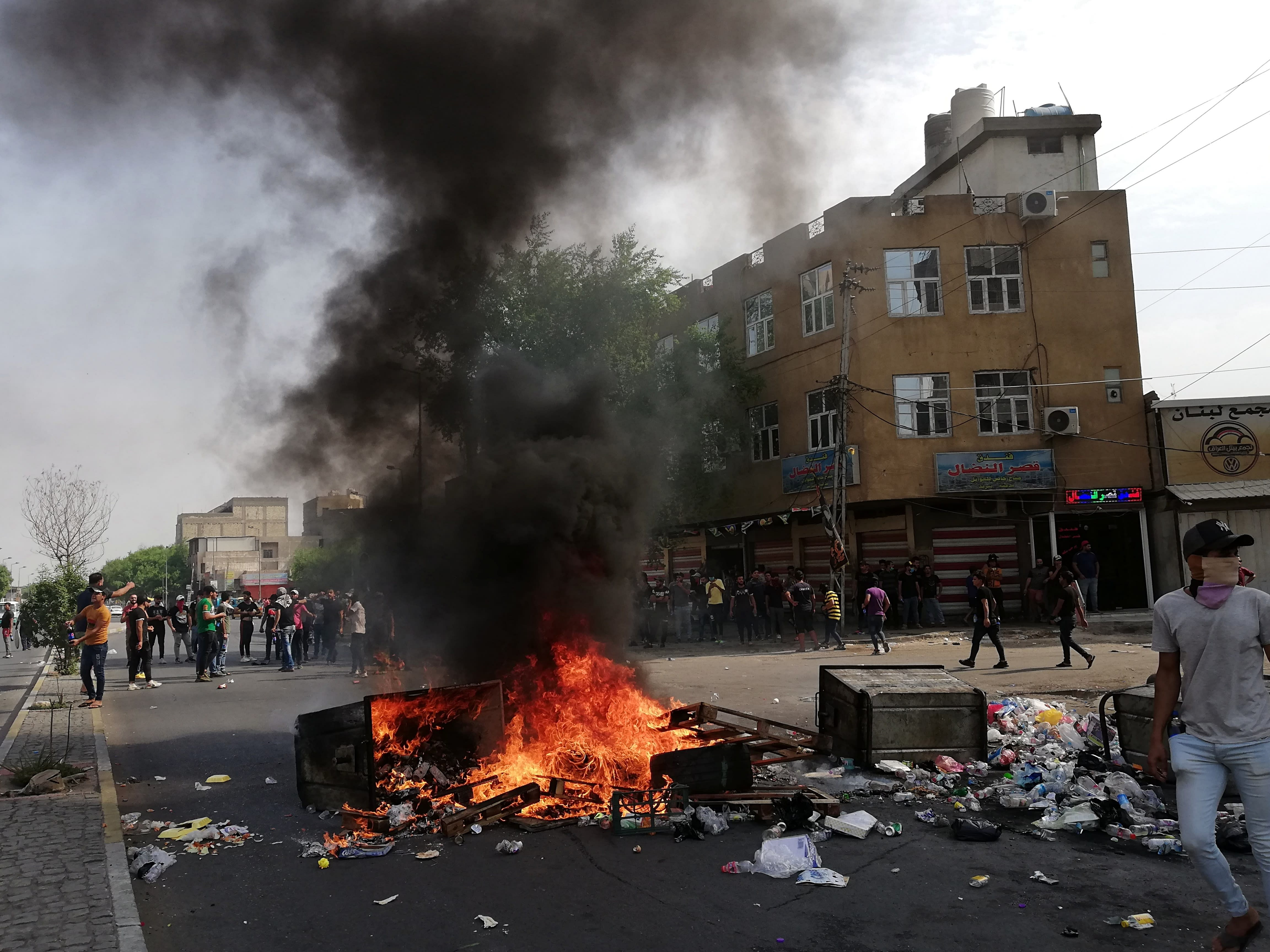 Anti-government protesters set fire and block roads in Baghdad, Iraq, Wednesday, Oct. 2, 2019. Security forces fired in the air and used tear gas Wednesday to disperse groups of demonstrators in Baghdad Wednesday, killing at least one and injuring six in renewed protests after violent confrontations between protesters and police a day earlier, officials said. (AP Photo/Hadi Mizban)
