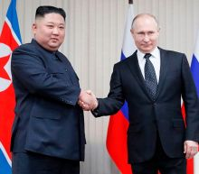North Korea's Kim Jong-un meets Vladimir Putin for first time in Russian city of Vladivostok