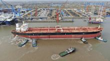 China stockpiles crude as prices collapse