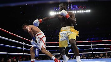 Crawford remains undefeated after TKO of Khan