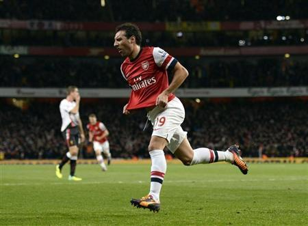 Arsenal's Cazorla celebrates after scoring a goal against Liverpool during their English Premier League soccer match at the Emirates stadium in London