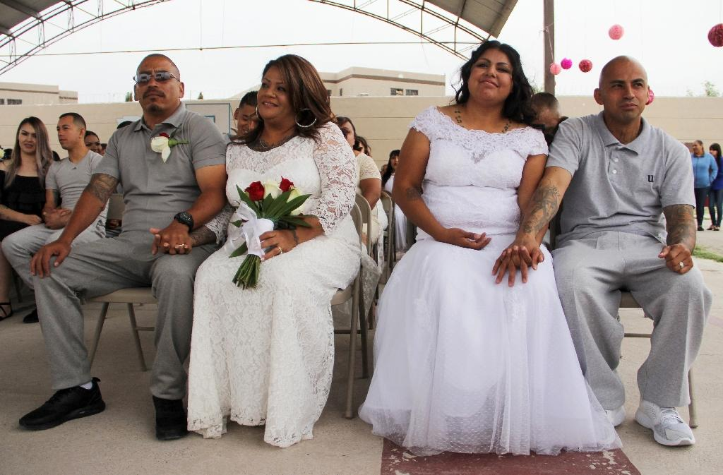 Some 63 couples have tied the knot at a mass wedding at a prison in the northern Mexican city of Ciudad Juarez (AFP Photo/HERIKA MARTINEZ)