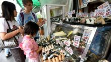 Japan spending picks up, inflation remains tepid