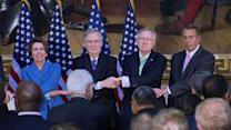 """Republicans, Democrats hold hands, sway to """"We shall overcome"""""""