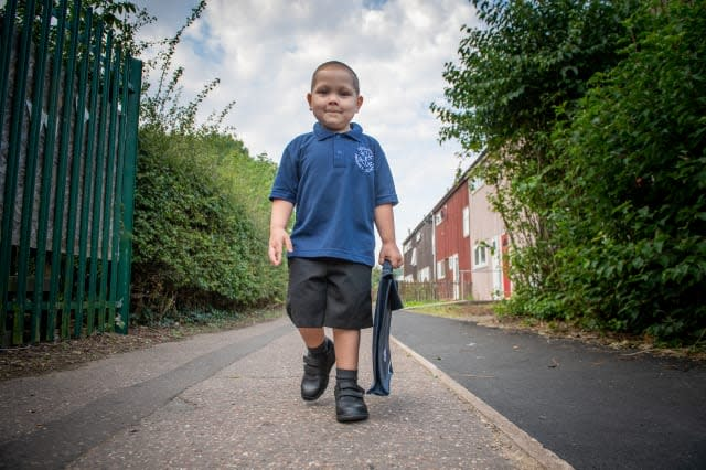 Four-year-old boy who has beaten leukaemia twice in his short life defies the odds to start first day of school